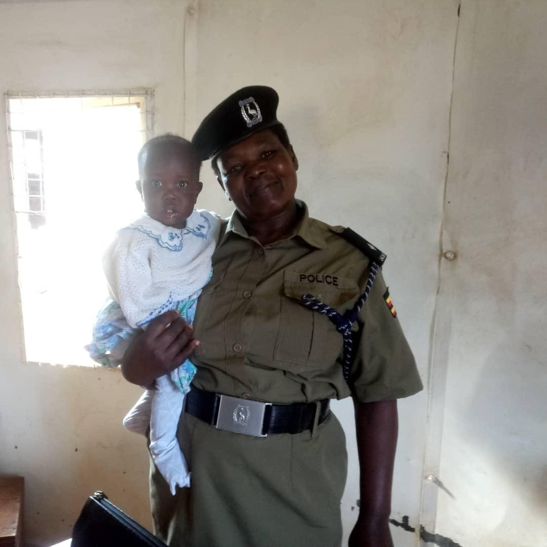 Family and Child's Protection Unit (FCPU) at Police Mukono is stranded with a baby found on a verandah of someone's home together with a suitcase. (PHOTO/PML Daily)