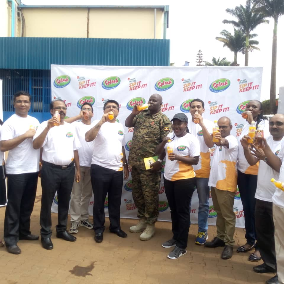 Staff of Britania Allied Industries joined by Juma Seiko unveil the new Splash in the PET Bottle. (PHOTO/Abraham Mutalyebwa)