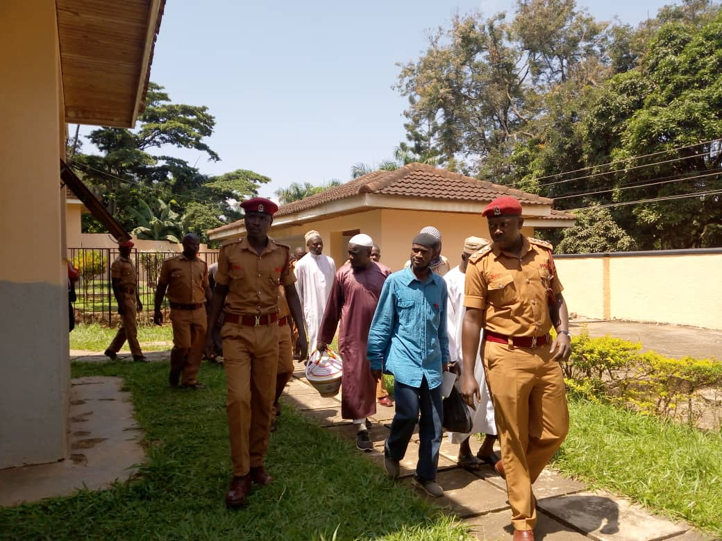 The eight Kaweesi murder suspects being led by the prison officers to court. (PHOTO/ Rachel Agaba)
