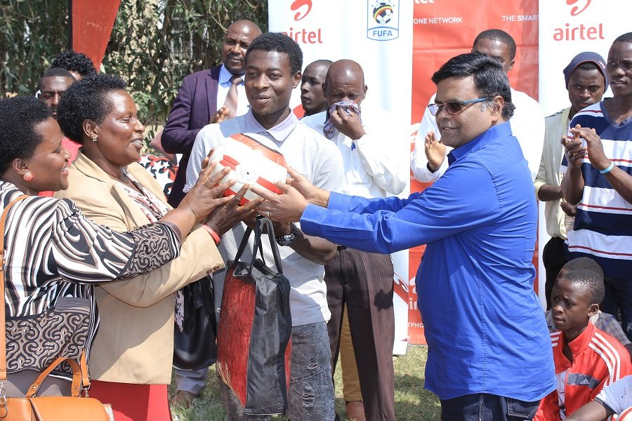Airtel MD VG Somasekhar handing out balls, goal posts and goal nets to enable the school to create sustainability in the sports section at Kabale Secondary School on Thursday.