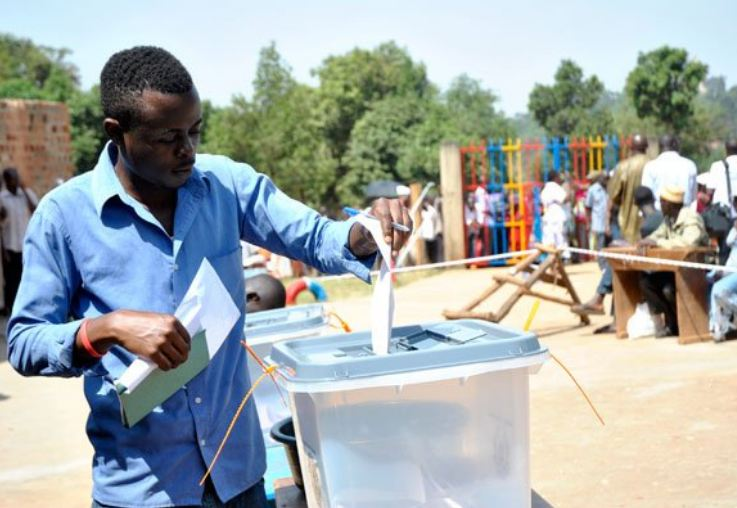 A resident casts their vote in the past General Election. Justice Simon Byabakama, the Chairperson of Electoral Commission had requested a ban of cameras on the polling stations (PHOTO/File)