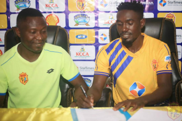 Ssekisambu (right) signing for KCCA FC. (PHOTO/Courtsey)