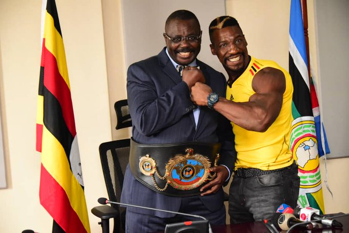 Boxer Moses Golola poses for a photo with Duputy speaker