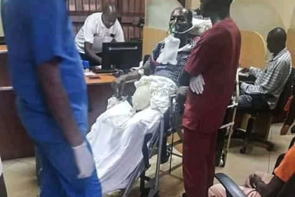 Mr John Zabazungu, who was wheeled to withdraw cash on Oxygen support, at Equity Bank headquarters at Church House in Kampala on Monday
