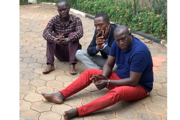 r Sam Buchanan (right) and his colleagues were arrested over allegations of conning foreigners in gold deals