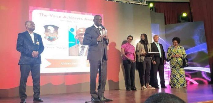 Dr. Besigye acknowledges his award as his wife, Ms Winnie Byanyima and their son Anselm Kizza Besigye in Nairobi Kenya.