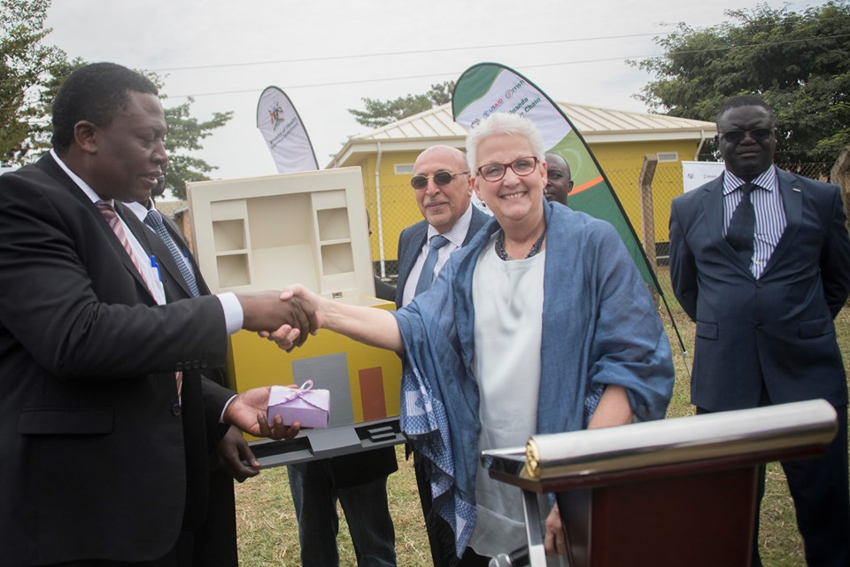 On behalf of Ministry of Health, the Director of Clinical Services, Dr Charles Olaro received the keys to 14 completed prefabricated storage units from U S Ambassador to Uganda, Deborah Malac.