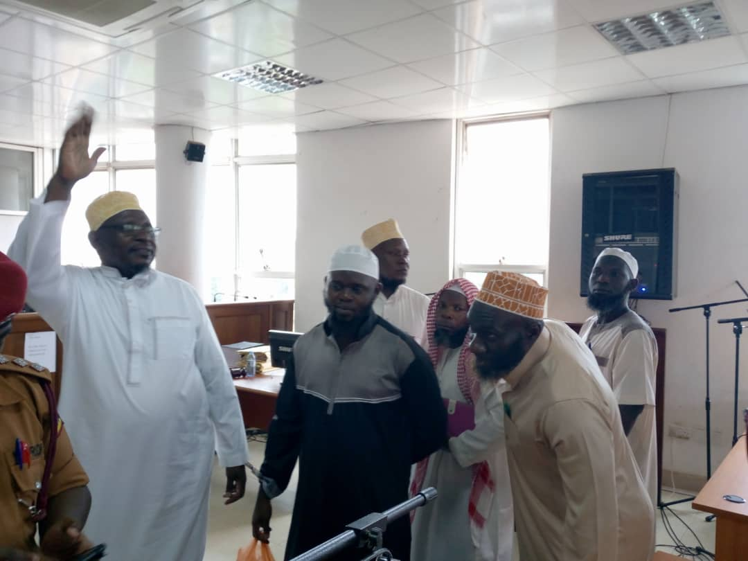 The former Tabliq Sect leader, Amir Umar Mohammed Yunus Kamoga waving to his people at the Court of Appeal together with other applicants. Photo by Rachel Agaba.