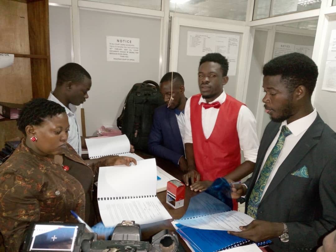 The petitioners L-R Francis Muganga, Kakaire Ramadhan, and Ali Kataba filing the petition at the Constitution Court registry. Photo by Rachel Agaba.