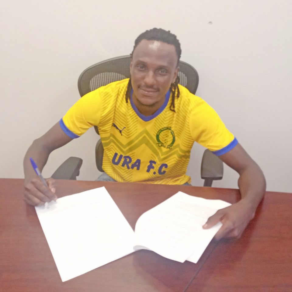 Michael Birungi posses in front of the camera after signing for URA FC on Wednesday. (PHOTO/URA FC)