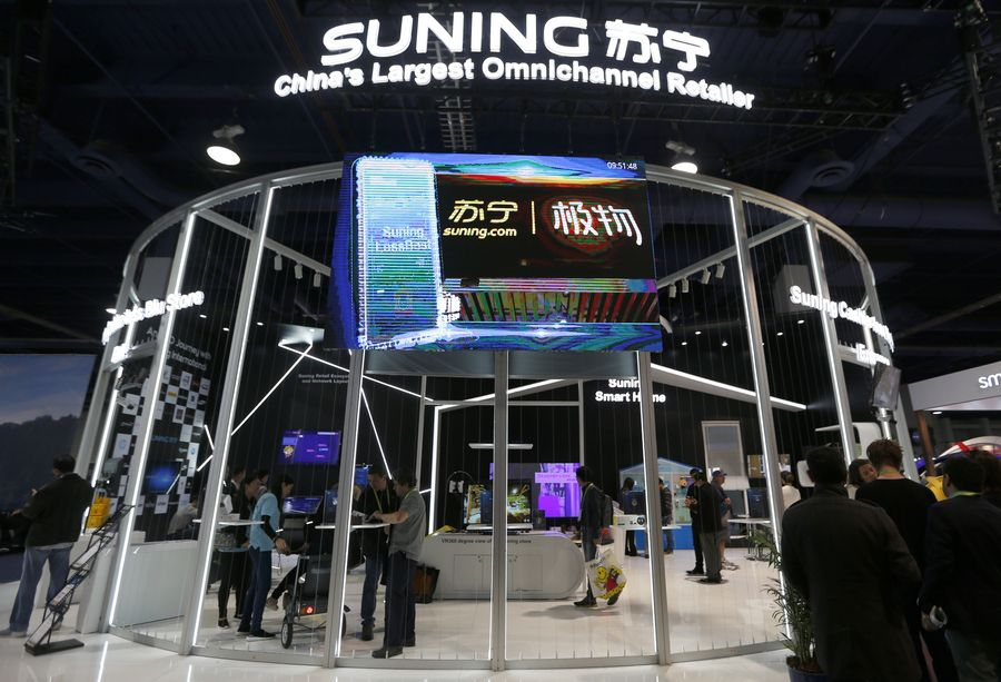 People visit the booth of Suning at the Consumer Electronics Show (CES) in Las Vegas, the United States, Jan. 9, 2018. (Xinhua