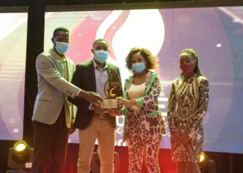 Kenneth Kazooba, Isma Lule and Nakyanzi Rose of StarTimes receiving the awards (PHOTO/Courtesy).