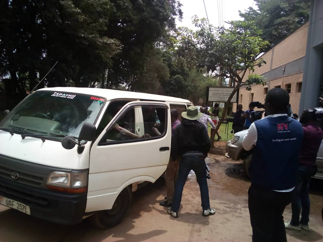 Security operatives pushing the Kaweesi murder suspects inside the van outside the Kololo based International Crimes Division of the High Court.  (PHOTO/Rachel Agaba.)