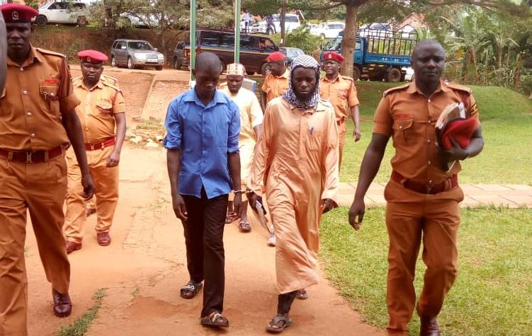 The three suspects being led to court for the hearing of their forgery case. Photo by Rachel Agaba.