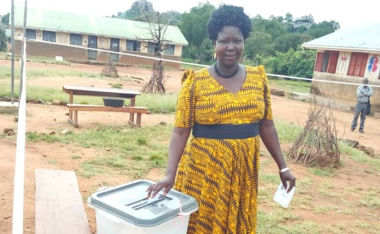 Mrs Christine Tubo the NRM candidate for Kaabong woman Member of parlimant casting her vote on Thursday at Kaabong police Primary school. (PHOTO/Jonathan Opolot)