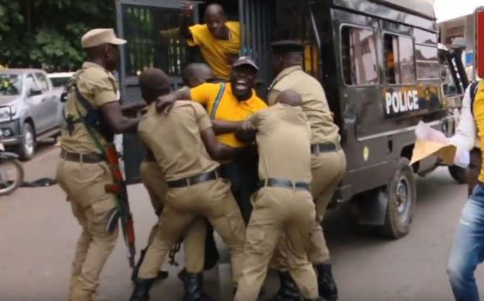 NRM youth being loaded on the police truck