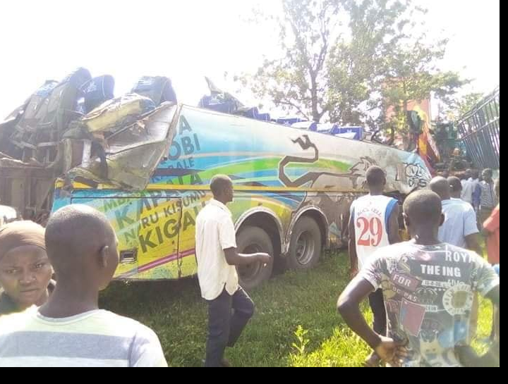 Residents at the accident scene at Nakawa, Busowa Town Council in Bugiri District on the Jinja-Tororo highway on