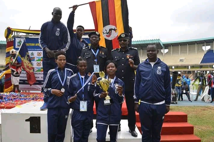 The Uganda Police team hold their 3rd place trophy. (PHOTO/Courtesy)