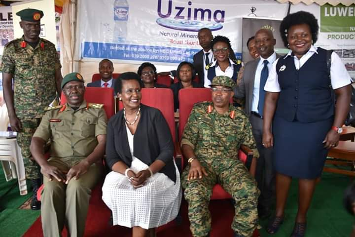 Trade minister Amelia Kyambadde (middle) has lauded UPDF for it's cooperate social responsibility at taxpayer's week. (PHOTO/PML Daily)