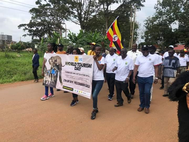 The great match from District headquarters to Pece stadium in Gulu to  mark the World Tourism Day. The walker in chief Prof. Ephraim Kamuntu the Minister Tourism Wildlife and Antiquities was joined by Hon. Kiwanda Godfrey Tourism Minister of State, UWA BoT, UWA ED and numerous partners. (PHOTO/Courtesy)