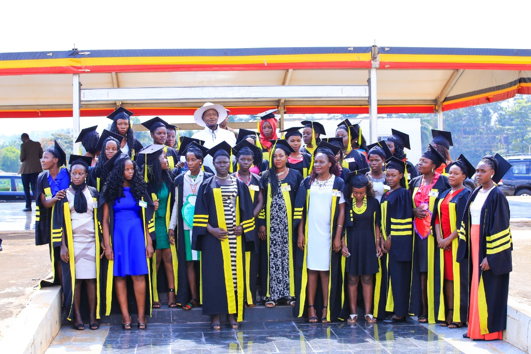 President Yoweri Museveni pauses for a group photo with some of the graduates from his program on skilling the Girl Child. (PHOTO/PML Daily)