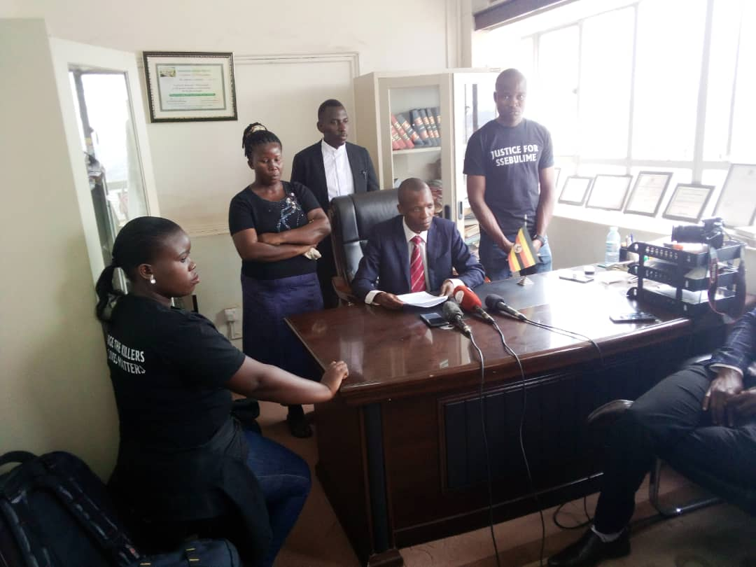 The family members of the late Ssebulime together with their lawyer Mr Muwada Nkunyingi while addressing journalists. (PHOTO/Rachel Agaba).