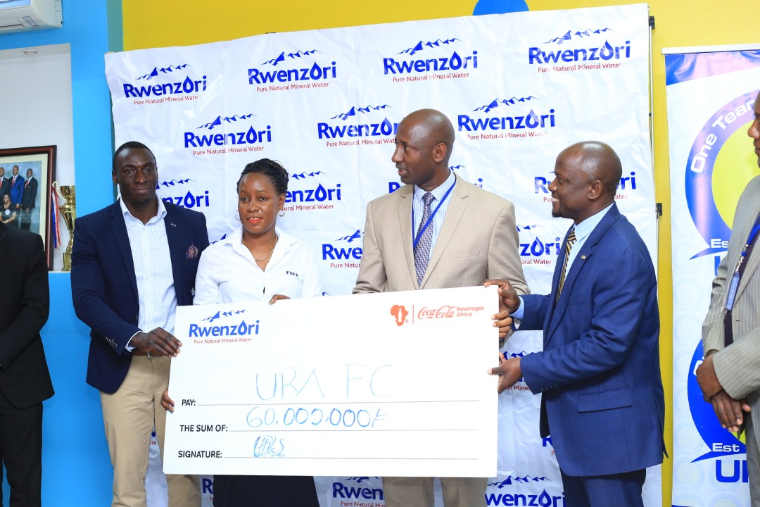 URA FC and Rwenzori Mineral Water officials display the UGX 60M cheque at the club's offices on Thursday. (PHOTOS/URA FC)