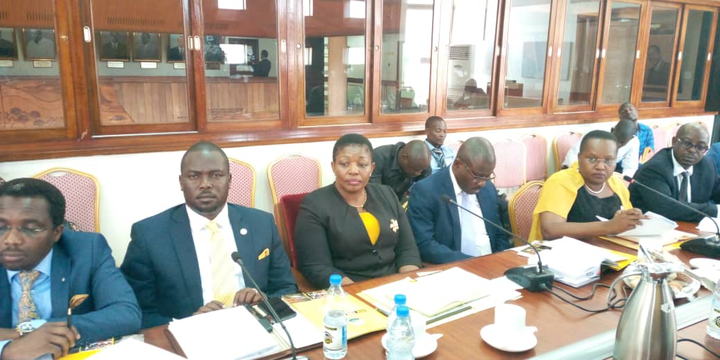 National Resistance Movement Secretary-General, Kasule Lumumba (3rd left) and colleagues appearing before the Legal and Parliamentary Affairs Committee on Tuesday (PHOTO/PML Daily)