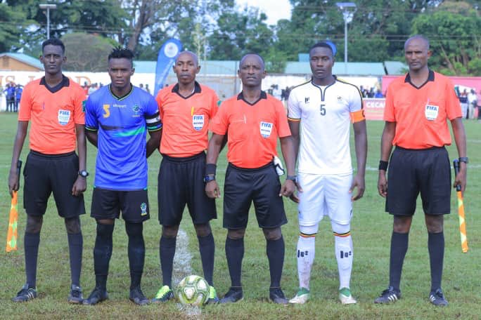 The two captains line up alongside the match official before the game on Sunday. (PHOTO/FUFA)