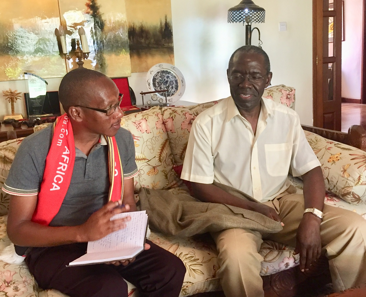 City tycoon Mohan Kiwanuka (R) during an interview at his home in Kololo recently (PHOTO/Courtesy)