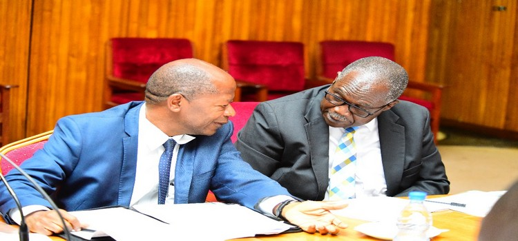 Muruli Mukasa(R) interacts with Education State Minister, Hon Muyingo