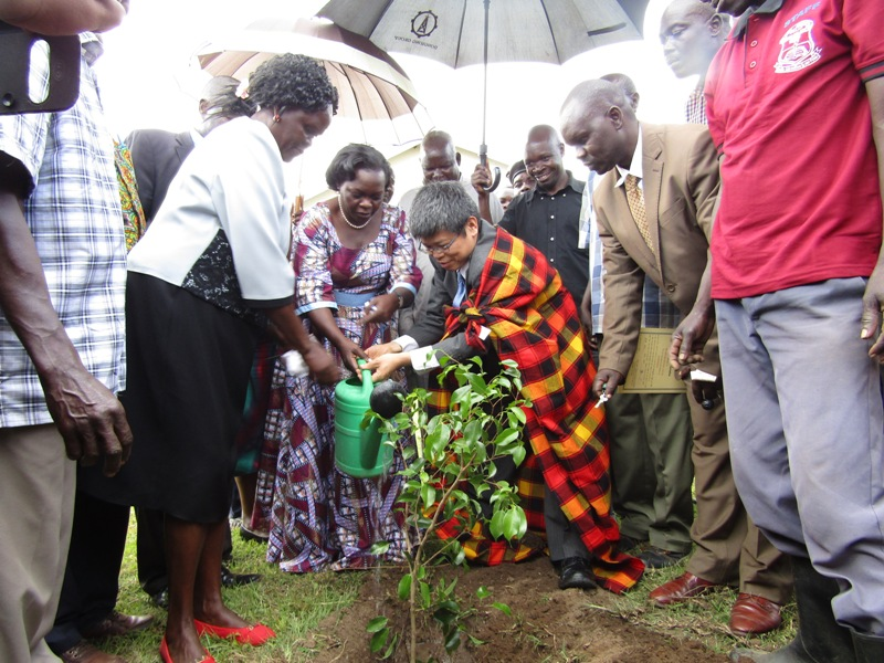 Minister of state for helath general duties Sarah Opendi and Mr. Mizumoto Horri the Japenese Ambassador to Uganda plant a tree in memory of commissioned structure. Photo by Joseph Omollo