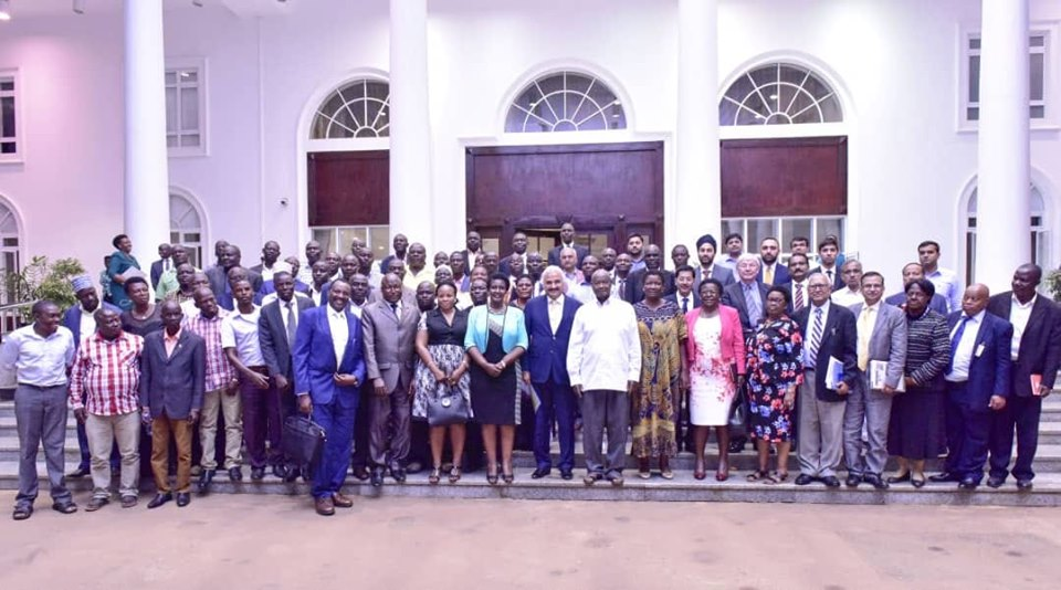President Museveni in a group photo with sugarcane business people after a meeting at State House Entebbe (PHOTO/PPU)