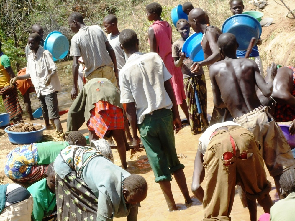 School going age children and their parents mining gold in Amudat last week district (photo by Jonathan Opolot