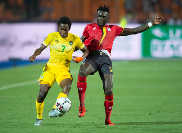 CAIRO, EGYPT - JUNE 26: Bevis Mugabi of Uganda and Talent Chawapihwa of Zimbabwe during the 2019 Africa Cup of Nations Group A match between Uganda and Zimbabwe at Cairo International Stadium on June 26, 2019 in Cairo, Egypt. (PHOTO/Courtesy)