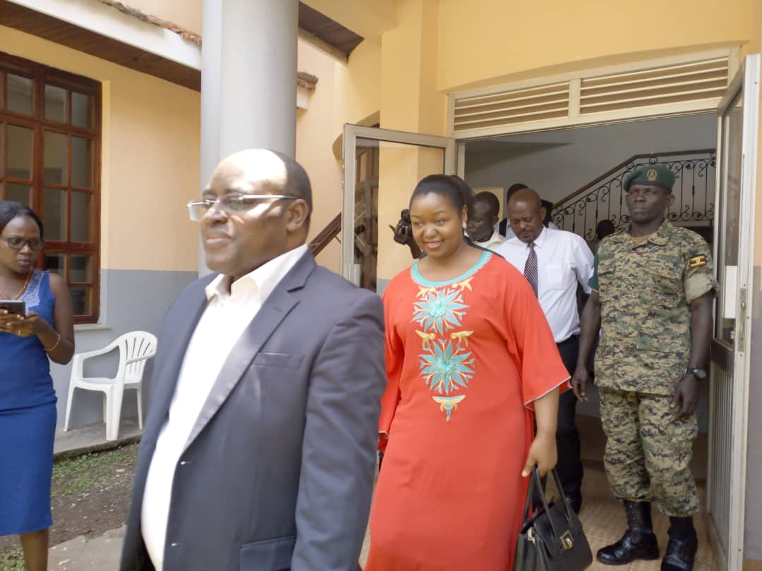 Rwenzururu King Charles Wesley Mumbere moving with his wife Queen Nyabaghole Agnes Ithungu Asiimwe at the International Division of the High Court after the hearing of his case. (PHOTO/ Rachel Agaba)