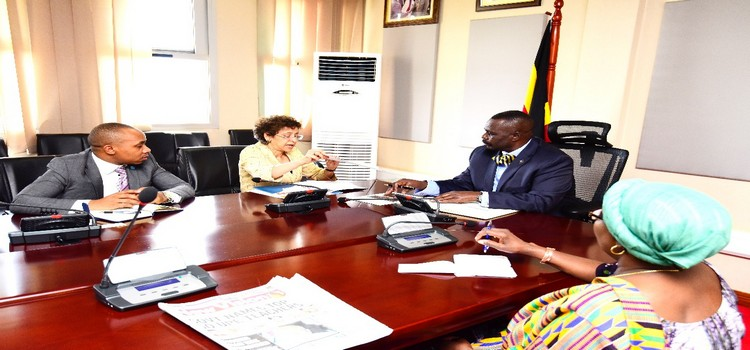 Oulanyah (2nd R) in a meeting with Khan(on his right) where they discussed funding for the bill