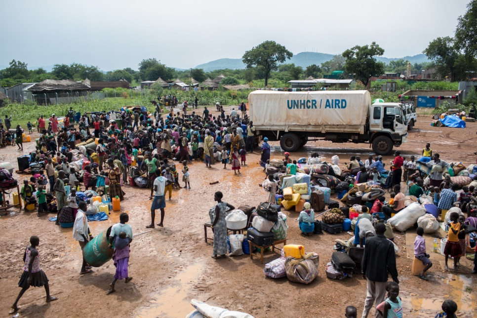 outh Sudanese refugees gather at a UNHCR collection centre on the South Sudan border in Egelo, Uganda.