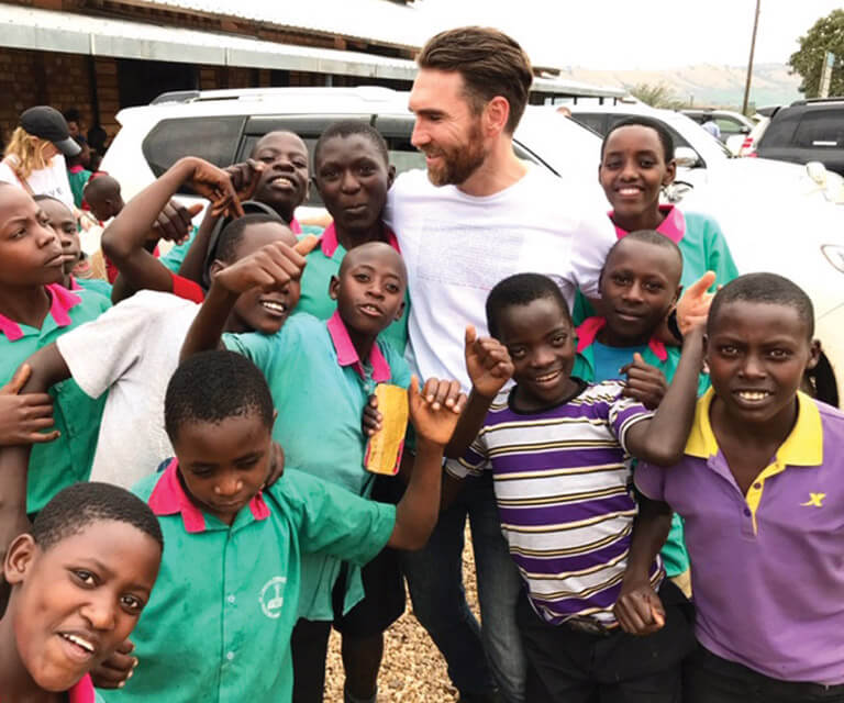Mr. Tim Diamond, the General Manager, Cotton On Foundation with some of the sponsored pupils in Southern Uganda. (PHOTO/File)