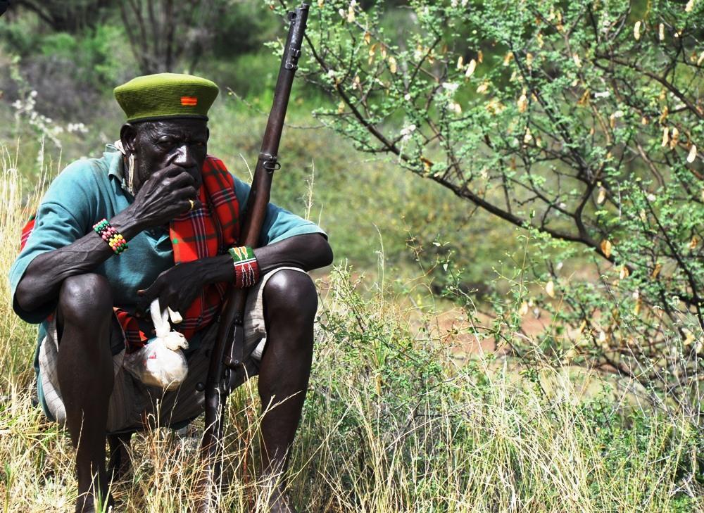 A Turkana pastoralist with his gun at the border of Uganda and Kenya grazing his animals (photo by Jonathan Opolot