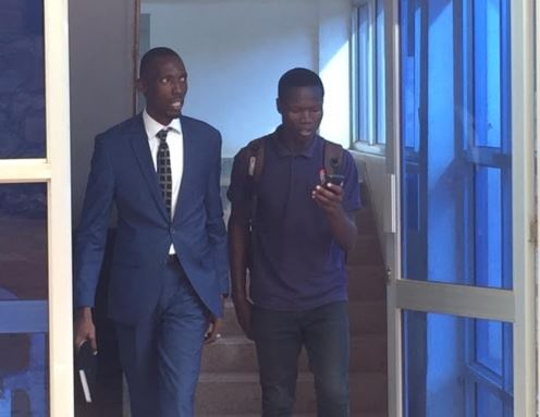 Counsel Walter Bwire and his client George William Eronda leaving the High Court in Mukono after the session
