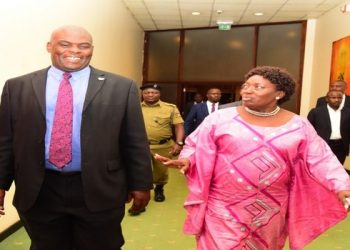 The Director of Public Prosecutions (DPP), Justice Mike Chibita (left) and Speaker, Rebecca Kadaga at celebrations to mark 10 years of passing of the Prevention of Trafficking in Persons Act, 2009 held at Kampala Serena Hotel on Wednesday