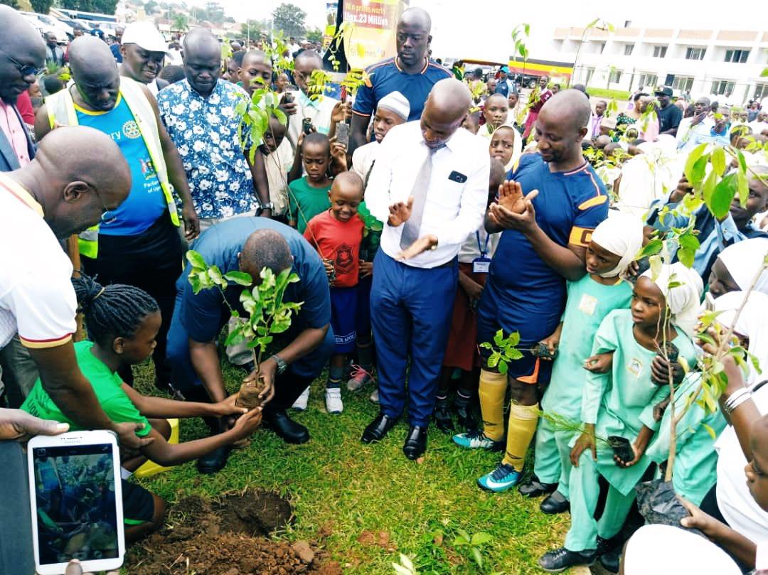 Deputy Speaker leading Kiira Municipality community in tree planting