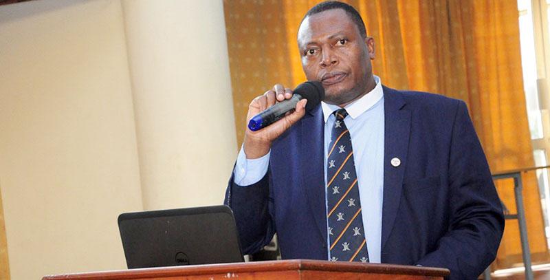 Dr Charles Olaro