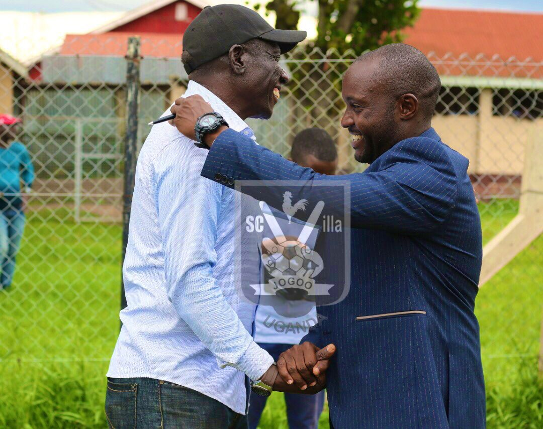 The two head coaches share pleasantries after the draw on Saturday. (PHOTO/Courtesy)