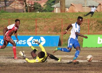 Madondo (right) dribbles past Express FC custodian Tony Kyamera to open the scoring on Tuesday. (PHOTO/Busoga United FC)