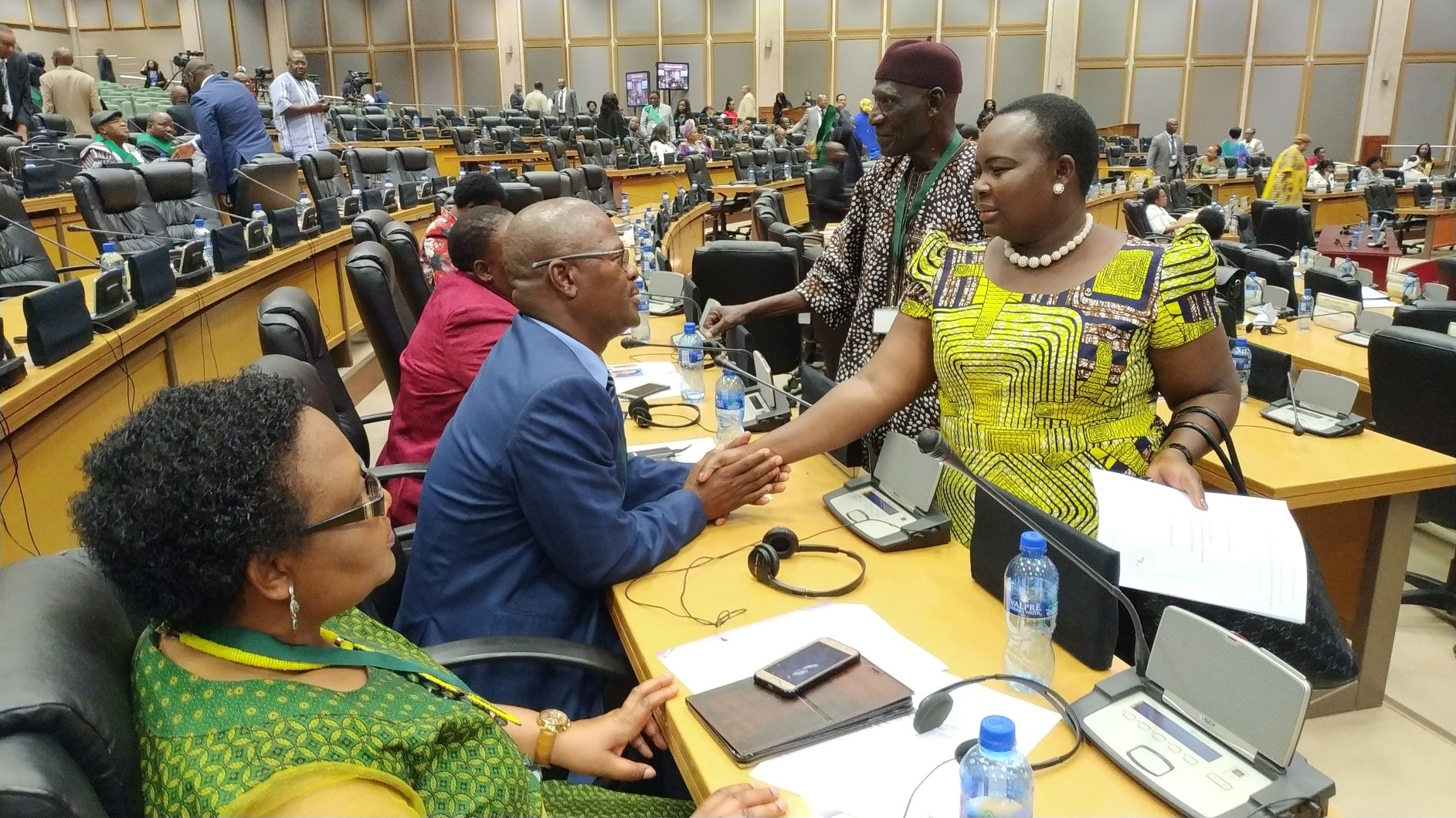 Hon. Jacquiline Amongin chatting with a colleague at the Pan African Parliament.