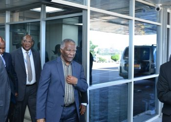 L- R  H.E Rtd. Major General Lekoa Solly Mollo, the South African high commissioner to Uganda looks on as former president of South Africa H.E Thabo Mbeki Arrives at Entebbe  International Airport on Monday , October  21,  (PHOTO/Abraham Mutalyebwa)