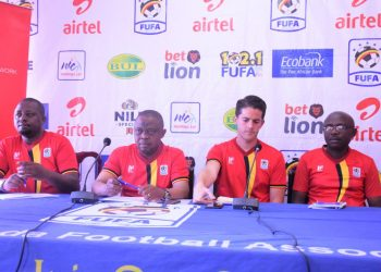 Fufa Deputy CEO in charge of football Decolous Kizza (right), Uganda Cranes head coach John McKinstry (second right), FUFA acting President Justus Mugisha (second left) and acting vice president Darius Mugoye (left) during an earlier function. He was asked to step aside for a month(PHOTO/File)