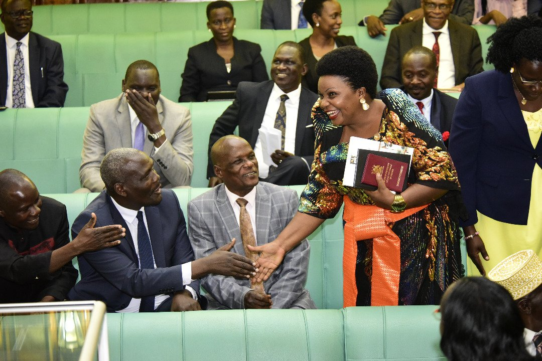 Male MPs fight to have a handshake with Hoima's Businge